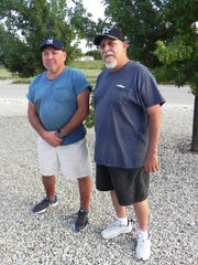 Jerry Fernandez, 62, (left) and David Fierro, 66, (right) posed for a photo after gathering to reminisce about their slow pitch softball days on the field with the team Bad Company. The team won the New Mexico Class C Men's ASA Slow Pitch state title in 1983.
