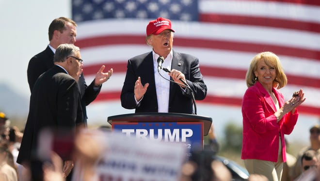 Republican Presidential candidate Donald Trump with Sheriff Joe Arpaio, JState Treasurer Jeff DeWitt and former Arizona Governor Jan Brewer