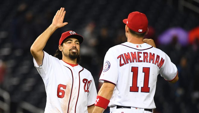 Nationals third baseman Anthony Rendon, left, and first baseman Ryan Zimmerman, right, celebrate after defeating the Mariners 10-1 at Nationals Park.