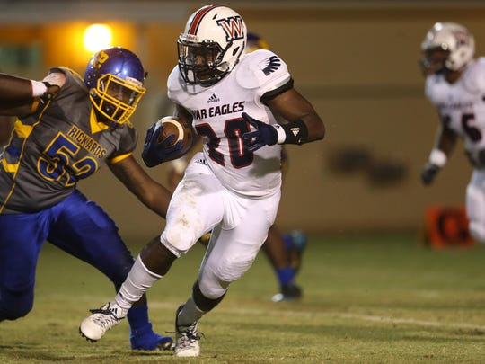 Wakulla's Brandon Berry runs the ball during their game against Rickards at Cox Stadium on Thursday night.