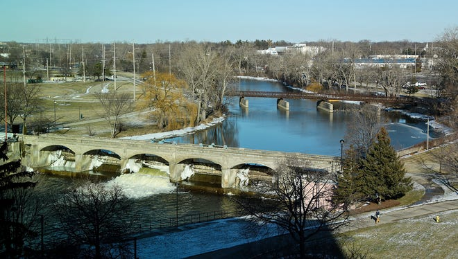 Flint river seen from Michigan State Office building Jan. 29, 2016, in Flint, Mich. The state announced an agreement with an engineering firm Tuesday, Feb. 16, 2016, to help identify and assess the condition of high-risk lead pipes in the city.