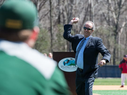Wicomico County Executive Bob Culver throws the first pitch during an opening day ceremony at the Henry S. Parker Athletic Complex on Thursday, April 5, 2018.