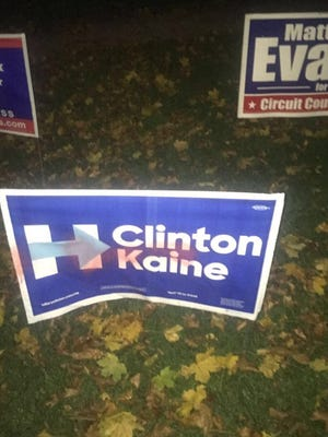 In a Livonia neighborhood on Election Day, vandals spray-painted red four signs for Democratic presidential candidate Hillary Clinton signs. Three cars that were parked in front of Clinton supporters' homes also were tagged by vandals.