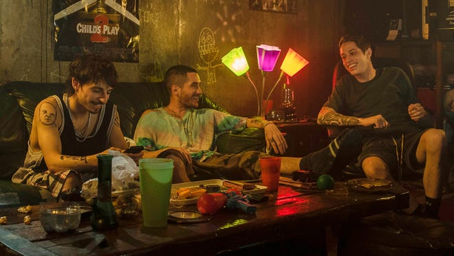 "Pete Davidson, right, with Ricky Velez and Moises Arias in ""The King of Staten Island."""