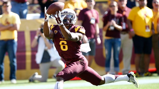 Arizona State's Cameron Smith makes a touchdown catch against Washington State in the second quarter on Saturday, Nov. 22, 2014, at Sun Devil Stadium in Tempe.