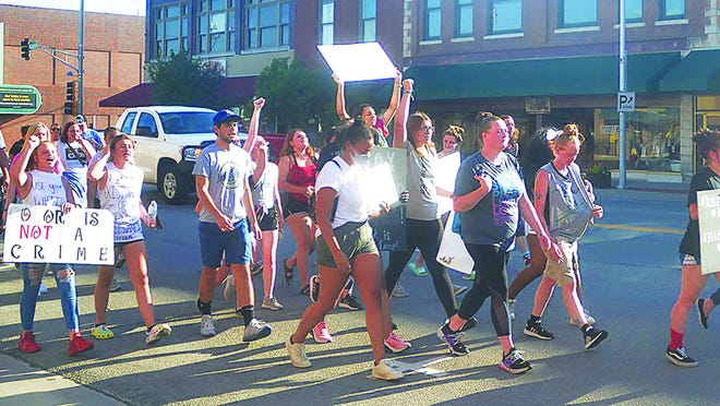 Protesters marched in Newton last week, bringing attention to a local victim of injustice, Matt Holmes.