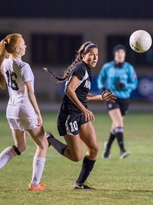 Emily Madril (10) goes after the ball during the Navarre vs Gulf Breeze soccer game at Gulf Breeze High School on Thursday, December 15, 2016.