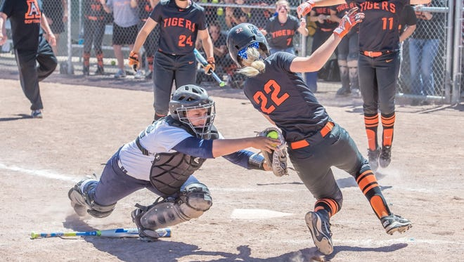 Piedra Vista's Haley Parson tags out Aztec's Sarrah Jones  at the plate on Thursday in Rio Rancho.