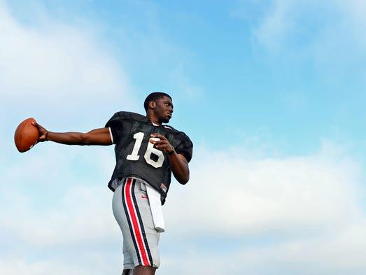 Ohio State Buckeyes quarterback J.T. Barrett (16) during practice at Ackerman Road Field.