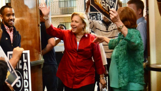 U.S. Sen. Mary Landrieu is greeted Monday as she enters a campaign rally at the Best Western in Alexandria.