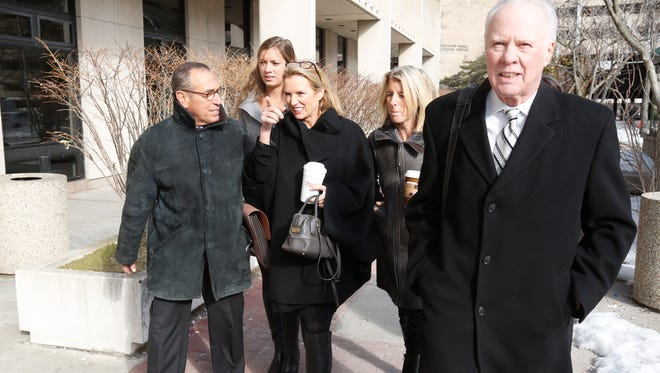 Kerry Kennedy along with her daughter Mariah Matilda Cuomo, second left, and sister Rory Kennedy along with her attorneys, enter Westchester County Courthouse in White Plains on her 4th day of trial on Feb. 27, 2014.