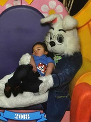 Ben Welser sits with the Easter bunny.