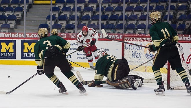 Noah Wolfram made 17 saves to earn the shutout for Howell in a 2-0 victory over Grand Blanc.