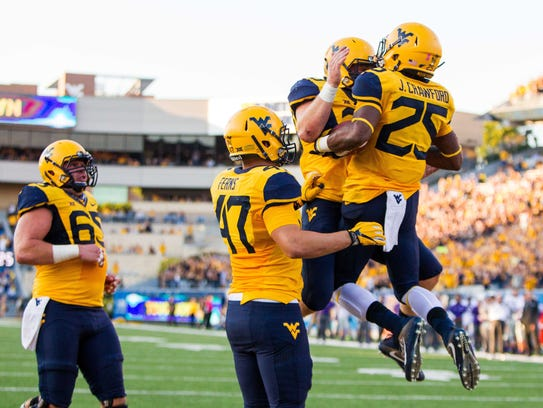 Justin Crawford (25) celebrates with teammates after