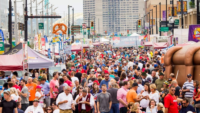 Crowds gather at Oktoberfest Saturday, September 17, 2016 at the new location on Second Street and Third Street in downtown Zinzinnati.