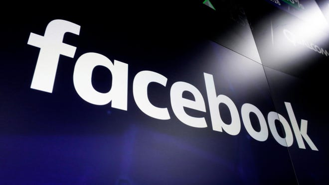 """FILE - This March 29, 2018 file photo, shows the logo for social media giant Facebook at the Nasdaq MarketSite in New York's Times Square. With just two months left until the U.S. presidential election, Facebook says it is taking additional steps to encourage voting, minimize misinformation and reduce the likelihood of post-election """"civil unrest."""" The company said Thursday, Sept. 3, 2020, it will restrict new political ads in the week before the election and remove posts that convey misinformation about COVID-19 and voting."""
