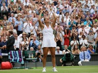 United States' Serena Williams and playing partner Britain's Andy Murray, top, in action against Fabrice Martin of France and Raquel Atawo of the United States in a mixed doubles match on day eight of the Wimbledon Tennis Championships in London, Tuesday, July 9, 2019.(AP Photo/Ben Curtis)