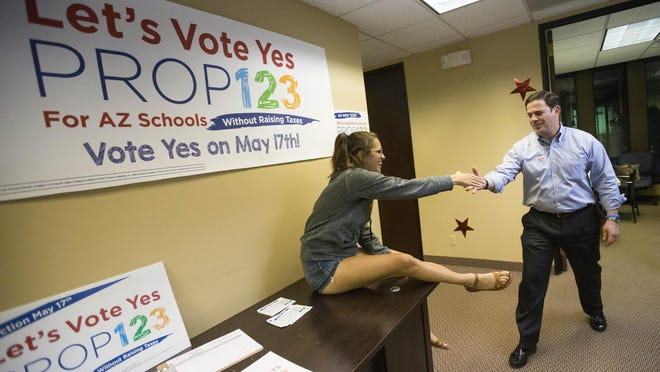 Prop. 123 intern Annie Warren shakes hands with Gov. Doug Ducey at the Yes on 123 Campaign Headquarters in Scottsdale May 17, 2016.