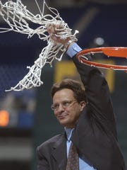 Marquette coach Tom Crean waves both nets at the Metrodome after his team defeated Kentucky to earn a trip to the Final Four in 2003.