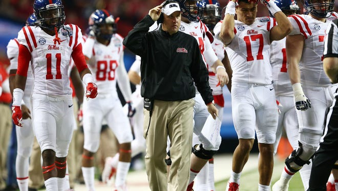 ATLANTA, GA - DECEMBER 31:  Head coach Hugh Freeze of the Ole Miss Rebels looks on in the third quarter against the TCU Horned Frogs during the Chik-fil-A Peach Bowl at Georgia Dome on December 31, 2014 in Atlanta, Georgia.  (Photo by Streeter Lecka/Getty Images)