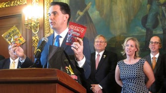 Gov. Scott Walker holds up two bags of Haribo candy during his announcement Thursday that the German-based company would be building its first North American manufacturing plant in southeast Wisconsin. Walker and his administration also is doing much to encourage entrepreneurship in the state.