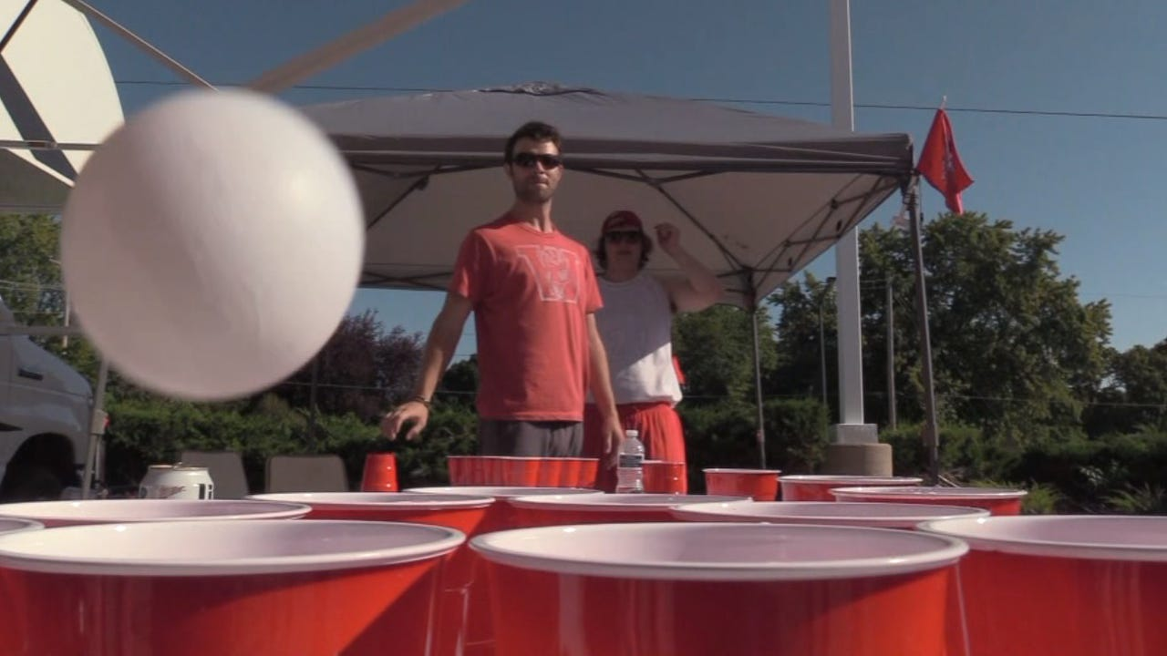 How do the two schools' tailgating styles differ?