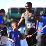 Justin Gatlin qualified for his third Olympic games by winning the 100-meter dash Sunday in Eugene, Oregon.