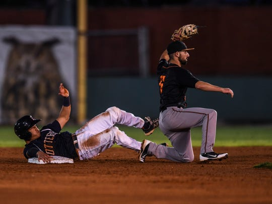 OttersÕ Kolten Yamaguchi (7) safely slides into second base as BoomersÕ Jack Parenty (5) catches the ball during the third inning of game two in the Frontier League Division series playoffs at Bosse Field in Evansville, Ind., on Wednesday, Sept. 6, 2017. The Otters defeated the Boomers, 4-3, and will head to Schaumburg, Ill., for game three.