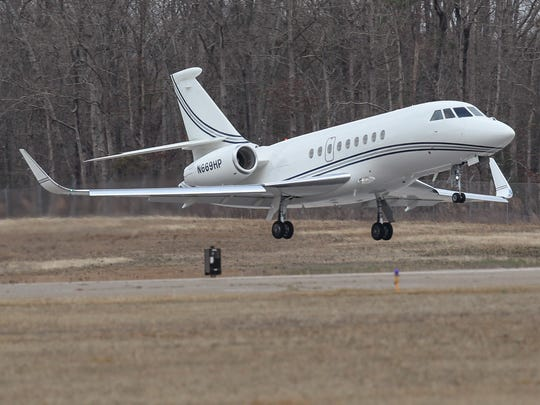 A corporate jet lifts off the runway at the Anderson Regional Airport in Anderson.