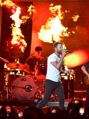 Dierks Bentley performs with Brothers Osborne at the 2018 CMT Awards Wednesday, June 6, 2018, at Bridgestone Arena in Nashville, Tenn.