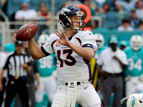 Denver Broncos quarterback Trevor Siemian (13) looks to pass, during the first half of an NFL football game against the Miami Dolphins, Sunday, Dec. 3, 2017, in Miami Gardens, Fla. (AP Photo/Lynne Sladky)