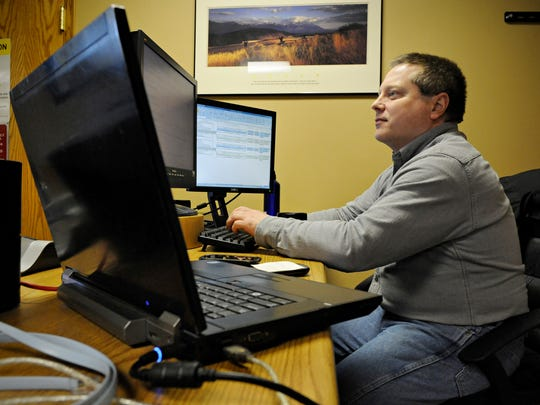 Mike Masog, network engineer, monitors the system at NewCore Wireless on Friday in the St. Cloud server room. A project between NewCore and Palmer Wireless will connect the St. Cloud location with a new fiber network in the Becker Industrial Park, possibly by the end of 2015.