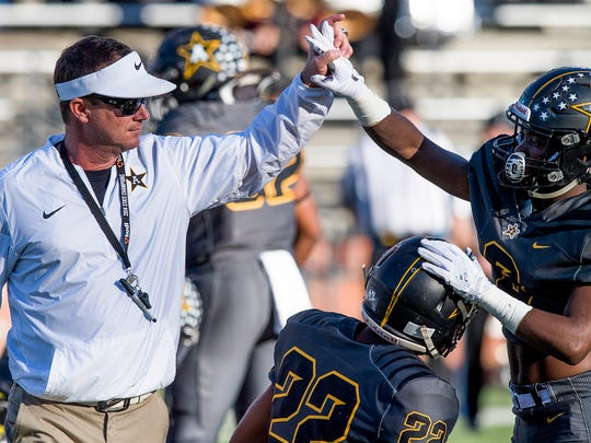Autauga Academy head coach Bobby Carr fires up his team before playing Escambia Academy in the AISA Class AA State Championship Football game in Troy, Ala. on Friday November 17, 2017.