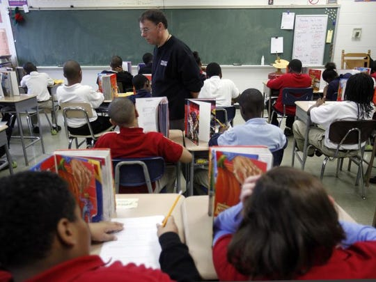 Dan Kriech, the co-creator of Project Restore, monitored students as they took a weekly math test in 2011 at School 99. Lewis Ferebee, the superintendent of Indianapolis Public Schools, wants the flexibility to create more charter school-inspired programs like Project Restore in the district.