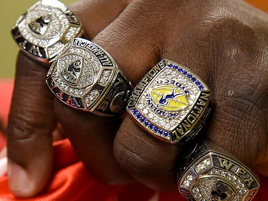 Mia Ben, M.D., shows off her national championship and All-America rings earned in the Women's Football League.