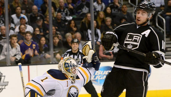 Buffalo Sabres goalie Jhonas Enroth (1) makes a save of a deflected puck by Los Angeles Kings center Mike Richards (10) in the third period of the game at Staples Center. The Kings won 2-0.