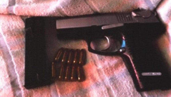 A photograph of a gun used as an exhibit in the federal case against Miquelle Depree Miller.
