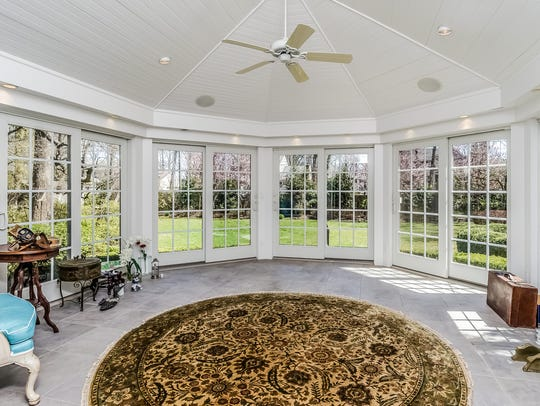 The sunroom features customized French doors which provide wonderful natural lighting.
