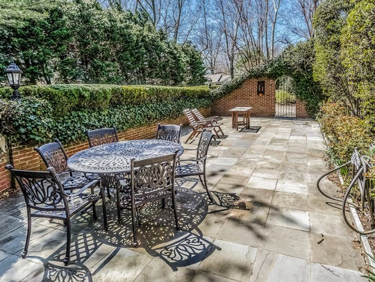 The patio features lavish greenery for all your privacy needs.