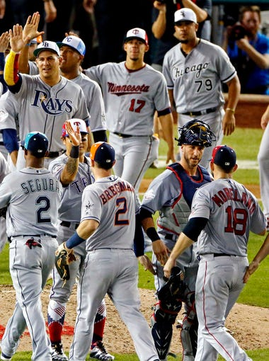 American League players celebrate the win.