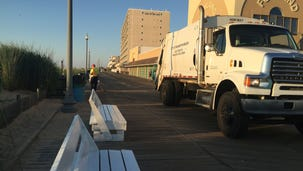 A beach rake sifts trash from the sand everyday during the summer in Rehoboth Beach while crews empty dozens of trash cans on the beach. The work is a challenge even through the crew starts at 4 a.m. Many visitors like to catch the sunrise.