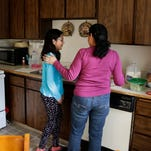 In this photo taken March 31, 2016, Teresa Garcia, right, walks with her daughter, Alondra Miranda, 11, as they leave their apartment for school in Federal Way, Wash., south of Seattle. Garcia, who has spent 14 years in the United States illegally after staying beyond the expiration of her tourist visa in 2002, is one of millions who could be affected when the political fight over immigration comes to the U.S. Supreme Court on Monday, April 18, 2016, as the court weighs the fate of Obama administration programs that could shield roughly 4 million people from deportation and grant them the legal right to hold a job.