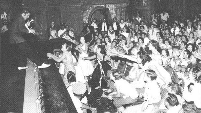Elvis Presley performs at the Olympia Theater in Miami in 1956.