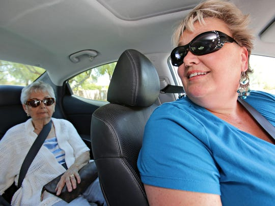 Lori Hyland, right, a driver for Envoy America, chats