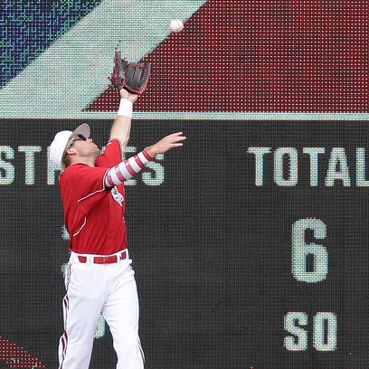 Louisville leftfielder Jake Snider can't grab a fly