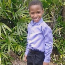 The 7-year-old boy shot Tuesday by his grandmother after she thought he was an intruder is improving, but is still in isolation at St. Joseph's Children's Hospital, according to the family's pastor.