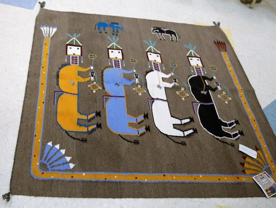 This sandpainting rug by Arnold Begay is included in