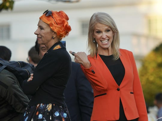 "Education Secretary Betsy DeVos, left, decided to turn Monday's White House Halloween party into a teachable moment, dressing up as Ms. Frizzle, the public school bus driver on the ""Magic School Bus"" book and TV series."