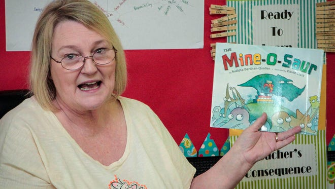 """Paulette Bobeck reads the book """"Mine-o-saur"""" to her pre-K class Friday, Sept. 9, 2016, at Tot's Landing in Murfreesboro."""