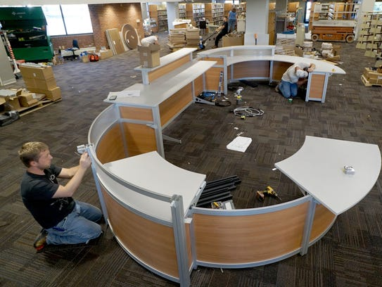 The front desk at the Ashland Public Library is assembled